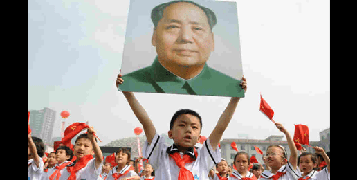 Chinese-school-child-holds-up-poster-of-Mao